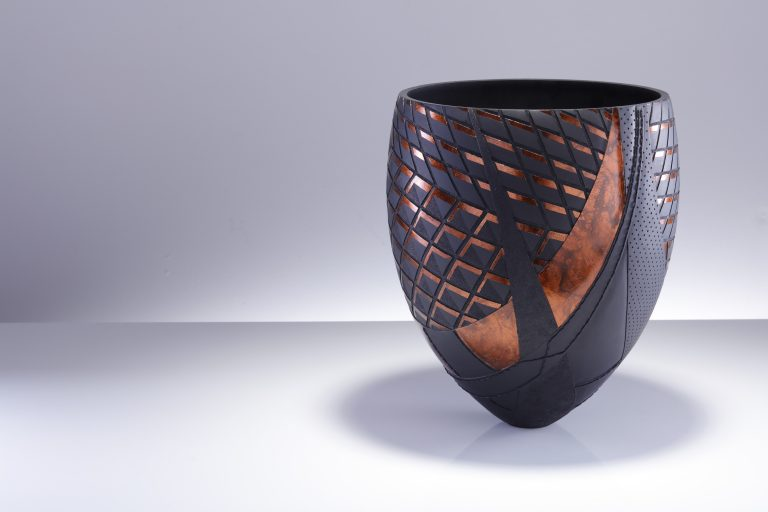 A wooden sculpture by Sally Burnett will be on display at the Lexus Takumi Townhouse during London Craft Week